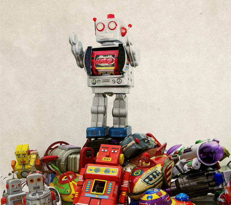 Robot toys. Big robot on top of a pile of robot toys royalty free stock image