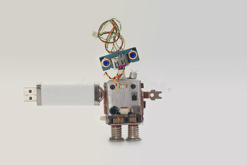 Robot with usb flash storage stick. Data storing concept, abstract computer character blue eyed head, electrical wire. Hairstyle. Copy space, gradient stock photos