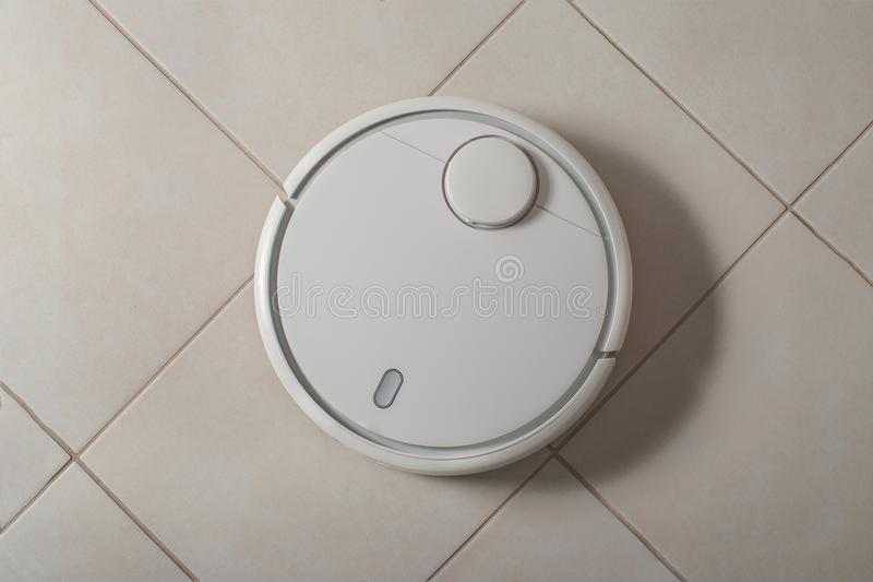 Robot Vacuum Cleaner With Shadow Cleaning Dust On Tile Floors ...