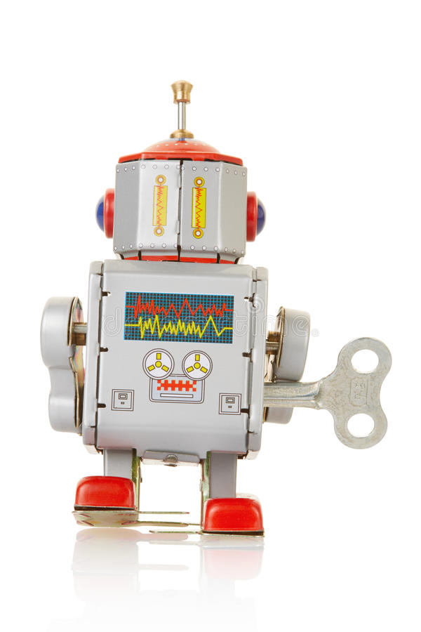 Robot vintage clockwork toy back. On white, clipping path included stock photos