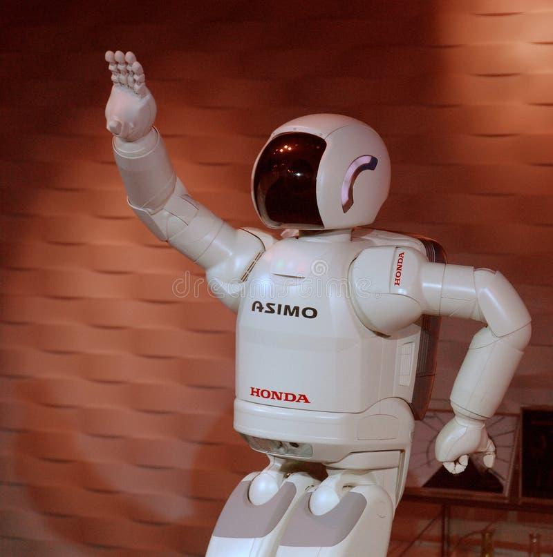 Robot waving royalty free stock photo