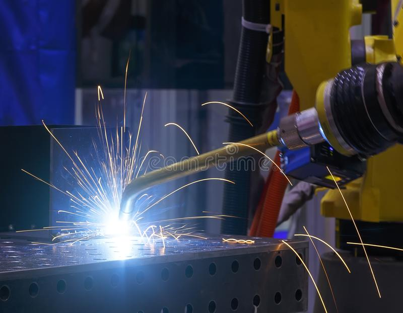 Robot welding movement Industrial automotive part in factory. Metal droplets are beautifully sprinkled in all directions stock images