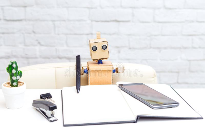Robot writes pen. Artificial Intelligence. Robot writes black pen. Artificial Intelligence royalty free stock photography