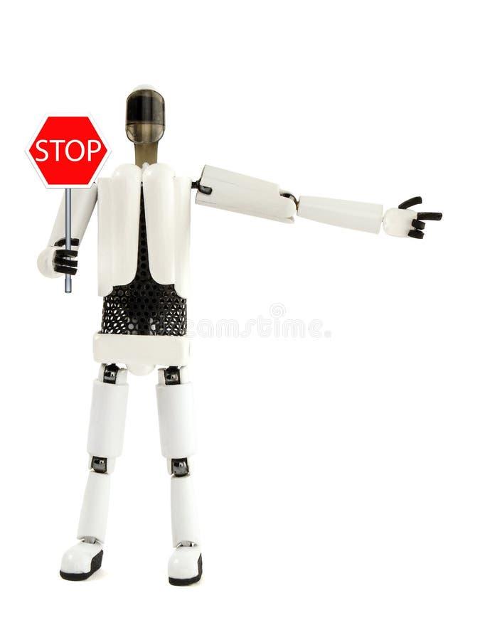 Roboten visar ett tecken av ett stopp och specificerar riktningen arkivfoton