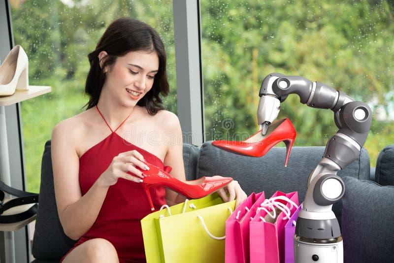 Roboterassistent mit glücklichen Einkaufsausgewählten Schuhen der hohen Absätze der frau, intelligentes Robotertechnologiekonzept stockbild