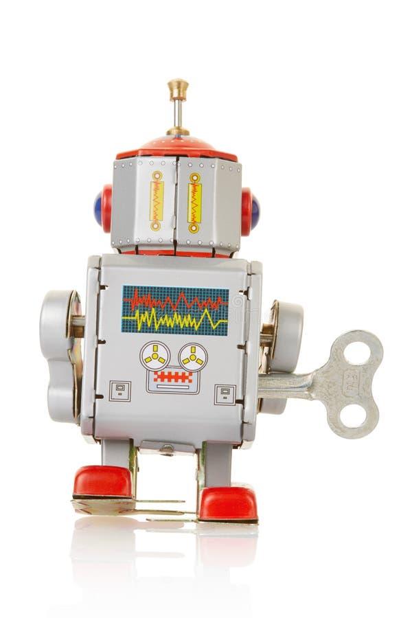 Roboterweinlese-Uhrwerkspielzeugrückseite stockfotos