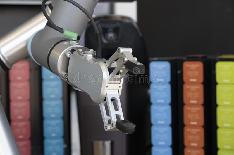 Robotic arm close-up. Background in various colors. Hand, machines, technology, innovation, reality, high-tech, morden, industry, industrial, production stock photos