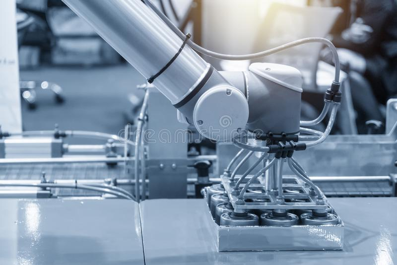 The robotic arm for food packing process in factory. royalty free stock photography