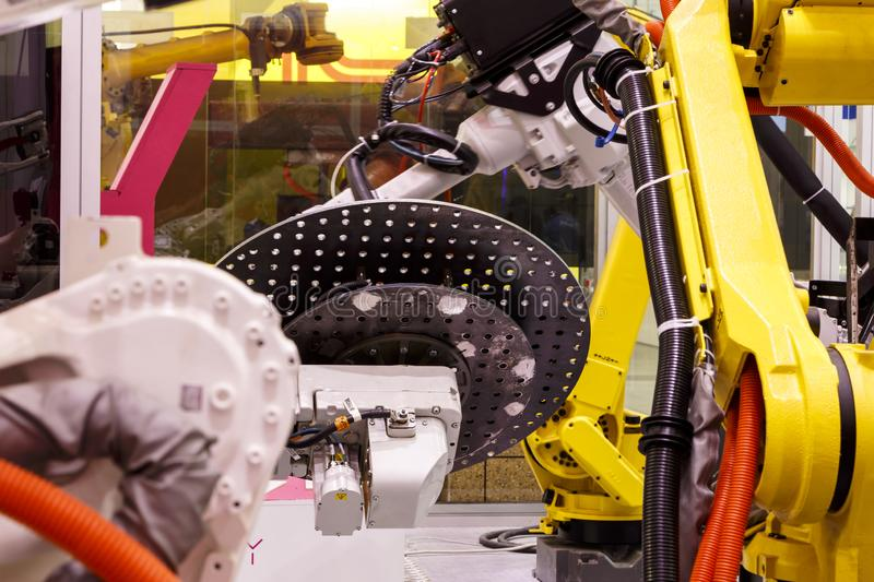Robotic arm manipulators on conveyor Robots working at smart factory royalty free stock image