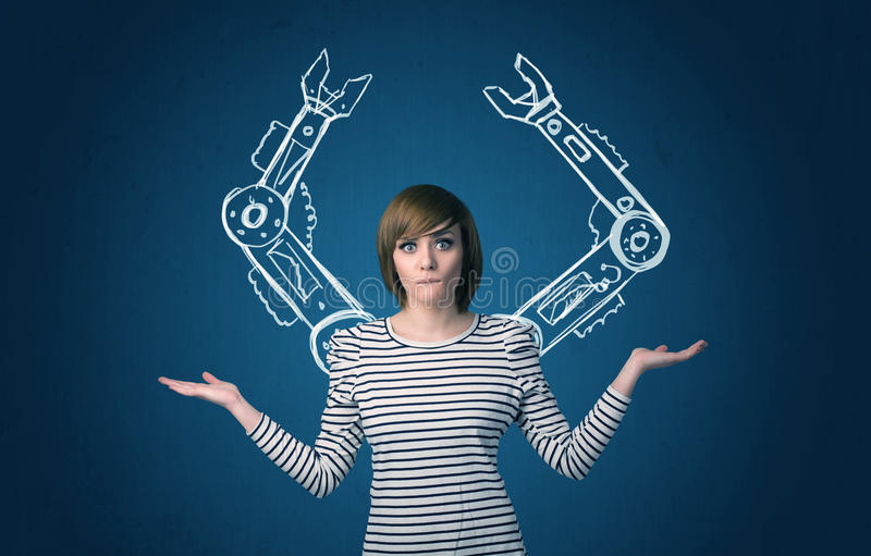 Robotic arms concept. Pretty young woman with robotic arms concept stock photography