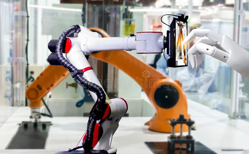 Robotic artificial automated manufacturing smart robot touch screen tablet royalty free stock images