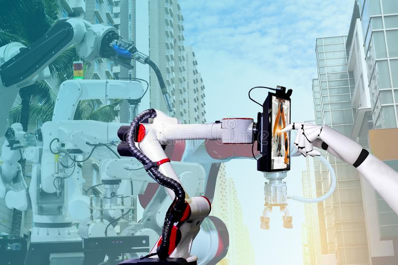 Robotic artificial automated manufacturing smart robot touch screen tablet stock photos
