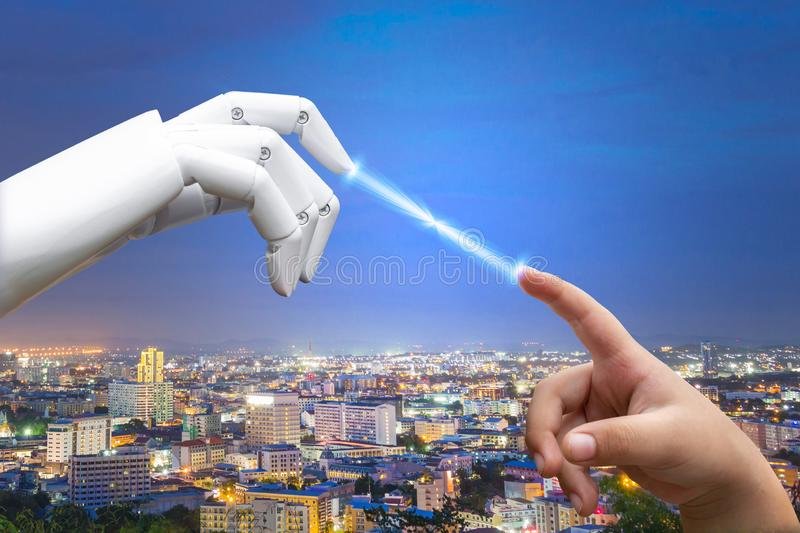 Robotic artificial intelligence future transition child human hand finger hit robot stock photo