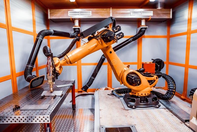 Robotic avlägset bitande system för fiberlaser fotografering för bildbyråer