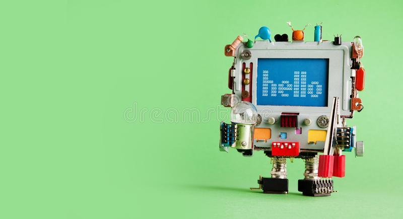 Robotic computer electrician with light bulb and red pliers in hands. Creative design robot toy, message Hello on blue. Screen. Green background. Copy space royalty free stock photo