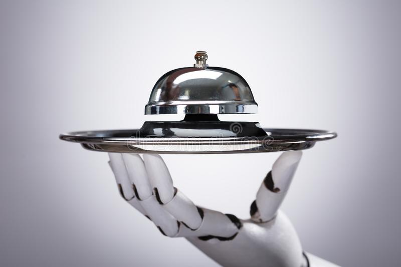 Robot Holding Service Bell In Plate royalty free stock images