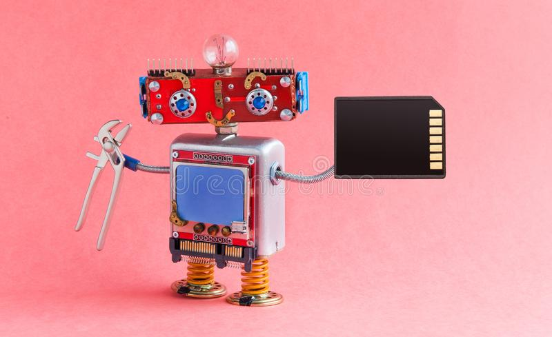 Robotic handyman electrician red head, blue monitor body, light bulb, pliers memory card. robot toy character cyberpunk. Machinery style. Pink background royalty free stock images