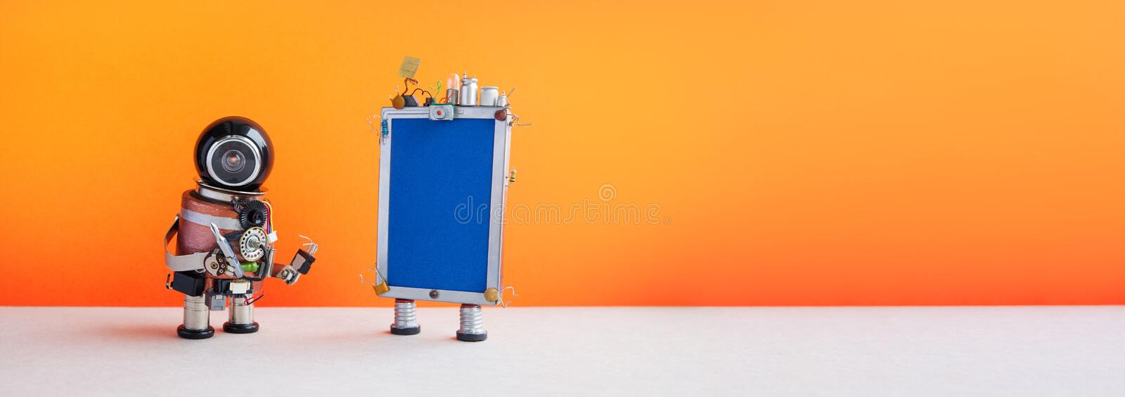 Robotic helpline customer service call center operator concept. Friendly robot assistant with modern phone on orange. Background. copy space royalty free stock photography