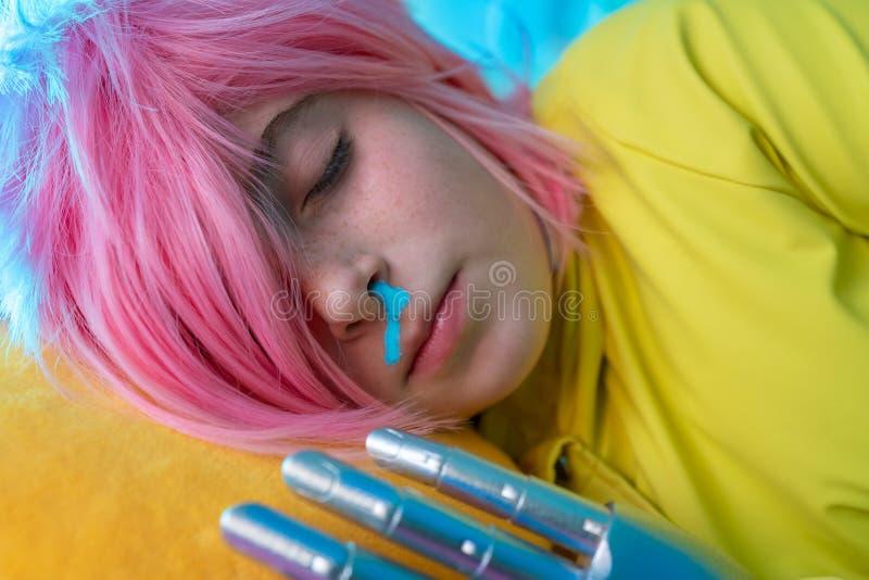 Robotic kid girl concept metal hand stock photo