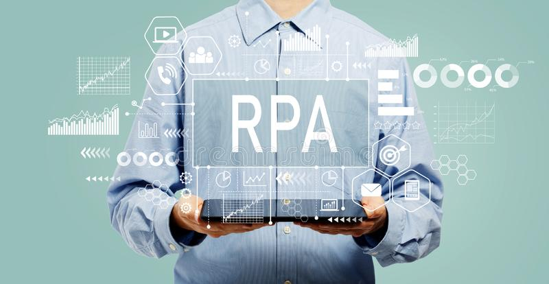 Robotic process automation concept with man holding a tablet royalty free stock images
