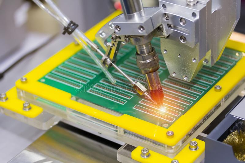 Robotic system for automatic point soldering for printed and assembly electric circuit board PCB at factory stock photo