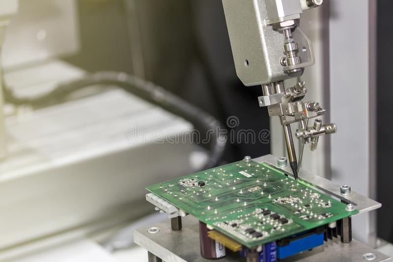 Robotic system for automatic point soldering for printed and assembly electric circuit board PCB at factory stock photos