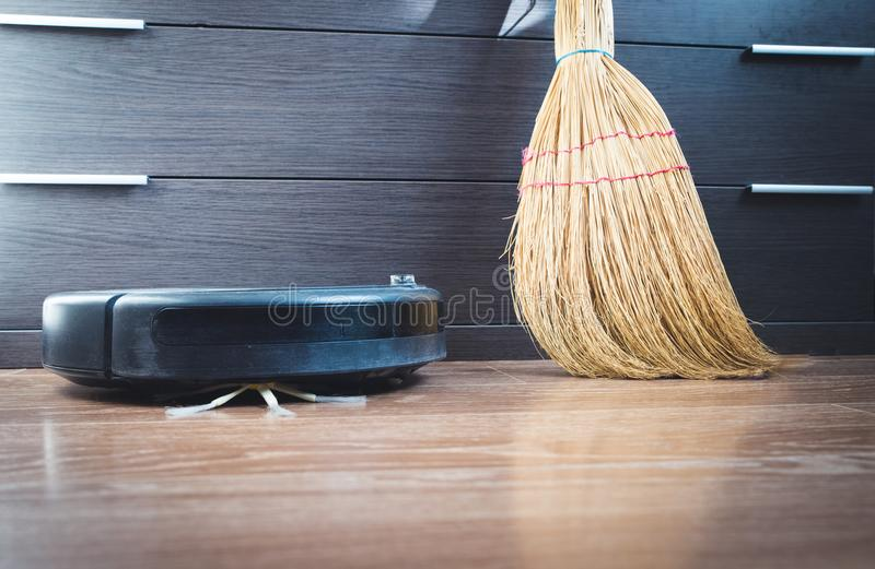 robotic vacuum cleaner on laminate wood floor smart cleaning royalty free stock photos