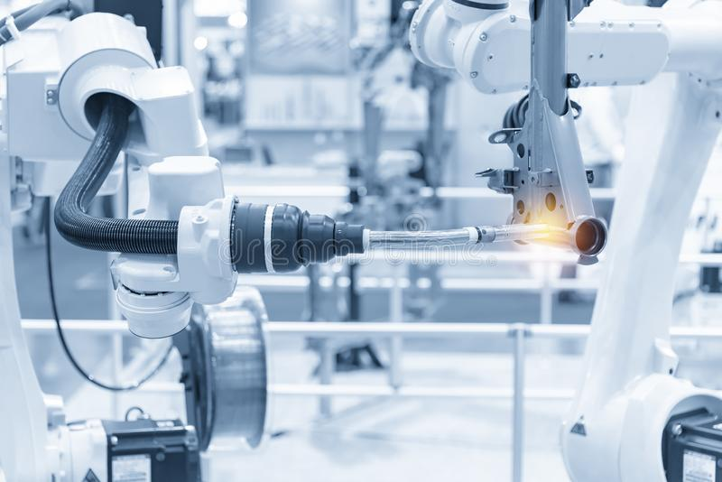 The robotics arm welding the automotive parts. The automobile  assembly  line with the autonomous  system royalty free stock image
