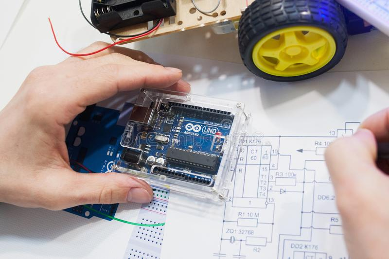 Robotics creation with arduino uno microcontroller. Ukraine, Kharkiv, 05.03.2017. Arduino Uno is a microcomputer that has its own memory and processor. The royalty free stock images