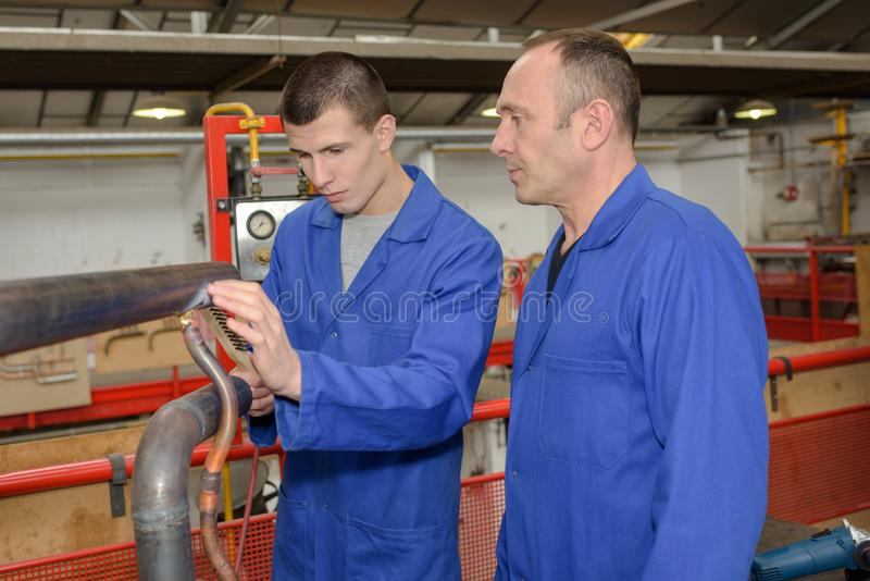 Robotics engineer student and teacher on project. Mechanical stock photography