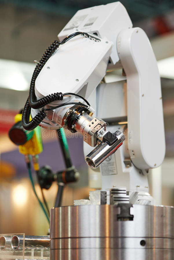Robotics. manipulator arm with detail. Robotics. Mechanical precision arm of robot manipulator with detail during positioning at facory stock image