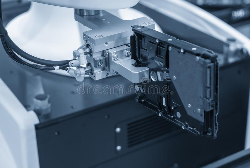 The robotics system handing the hard disk parts on assembly line. royalty free stock images