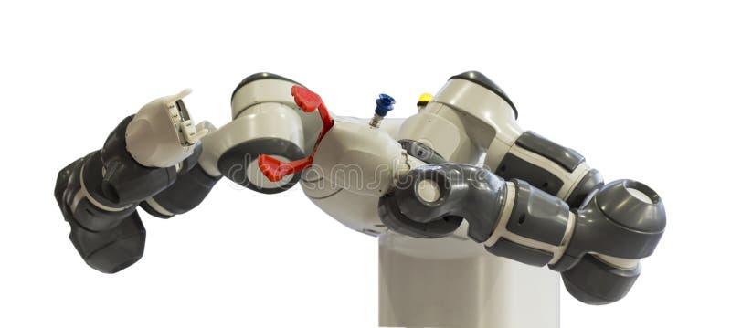 Robotiska vapen för plockning och placering av automatisering; process för att ta upp delar och placera dem på en ny plats royaltyfri bild