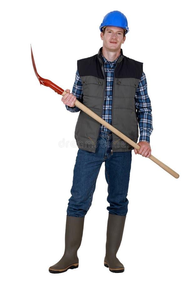 Robotnik trzyma rydel zdjęcie royalty free