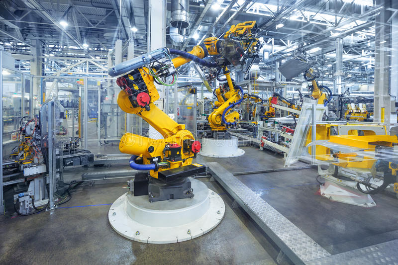 Robots in a car plant royalty free stock photography