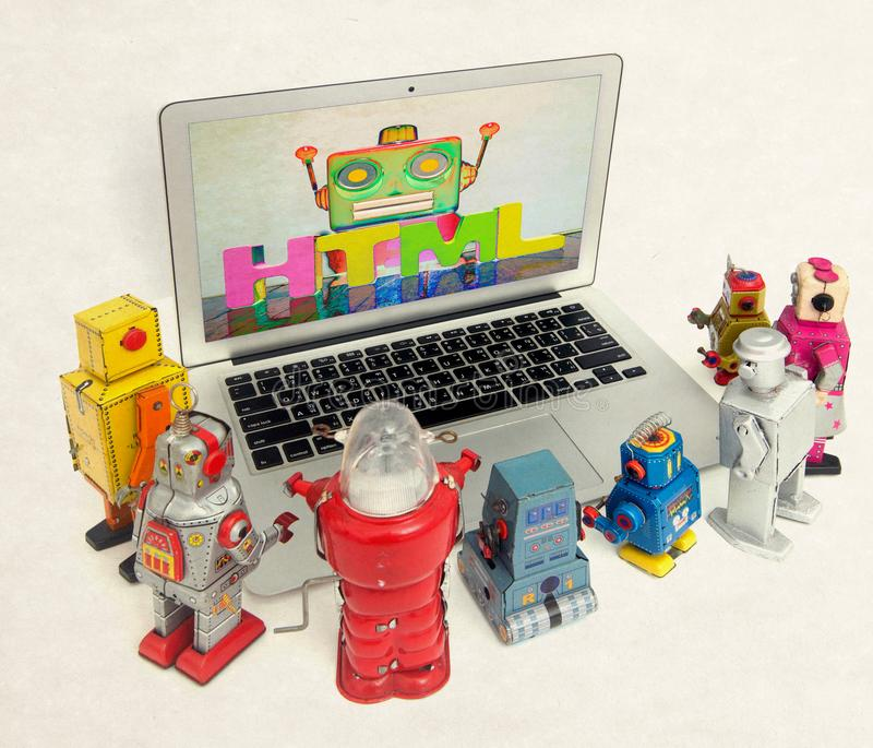 Robots chat to each other in a laptop stock image