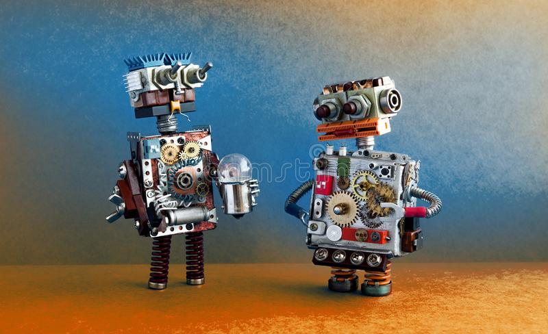 Robots communication, artificial intelligence concept. Two robotic characters with light bulb. stock photos