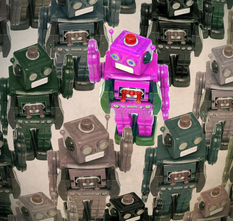 Robots crowd. Lots of robots in a crowd with one pink robot going the other direction royalty free stock photo