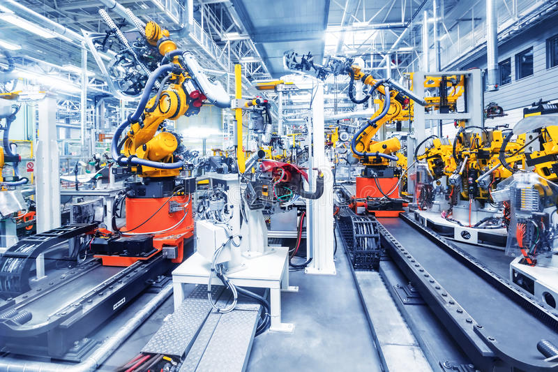 Robots in een autofabriek royalty-vrije stock fotografie