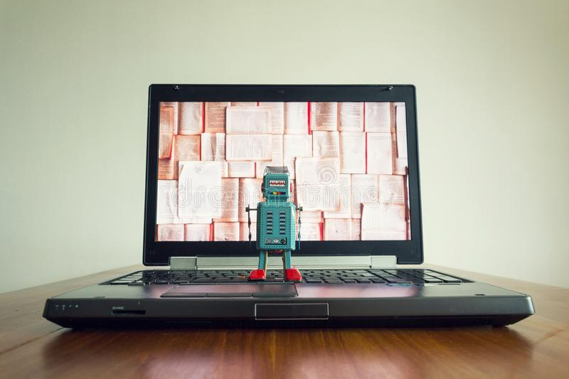 Robots with books screen, big data and deep learning concept stock photography