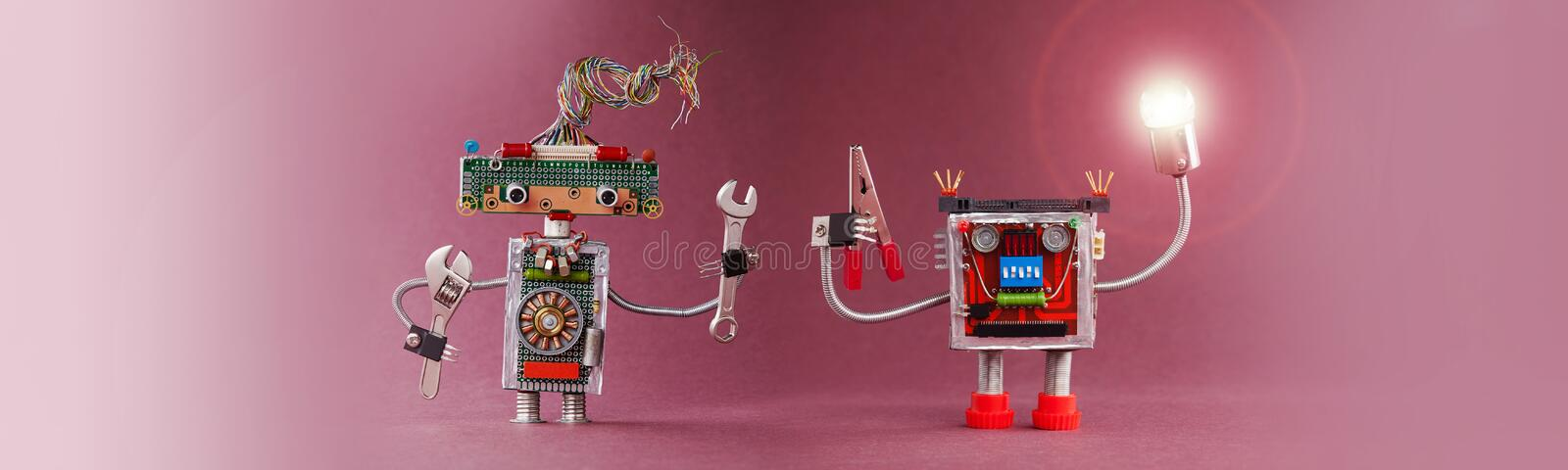 Robots 4th industrial revolution automation concept. Robotic handyman lights the way. Friendly mechanic toys with lamp. Red pliers hand wrench. Pink violet stock image
