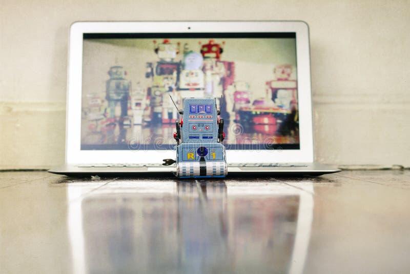 Robots watching stock image
