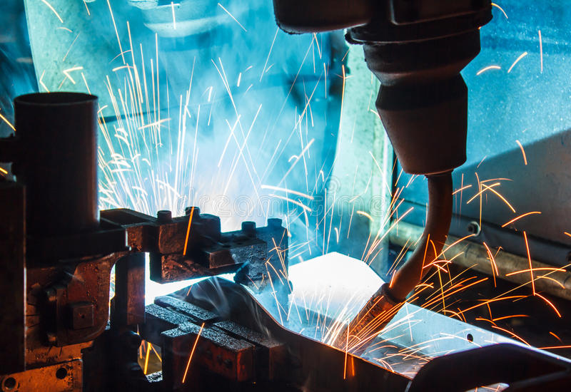 Robots welding in a car factory. Welding robots movement in a car factory royalty free stock photo