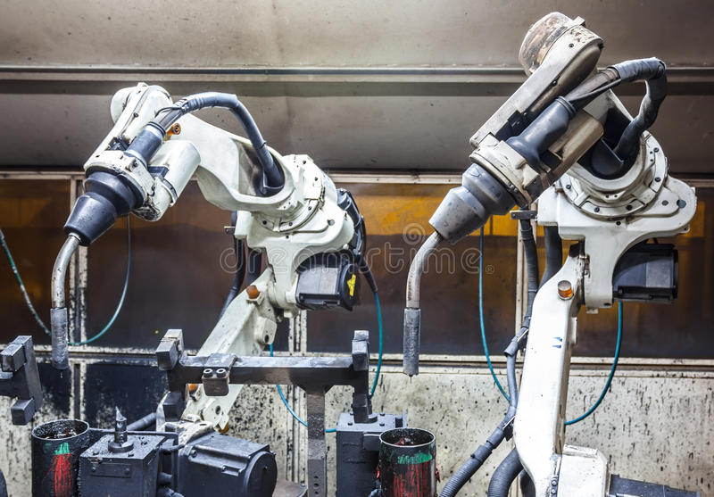Robots welding team in the automotive parts stock images