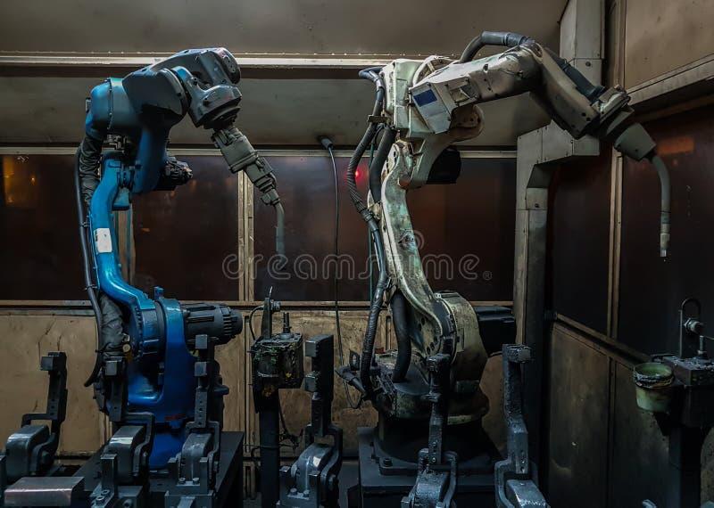 Robots welding team royalty free stock photos