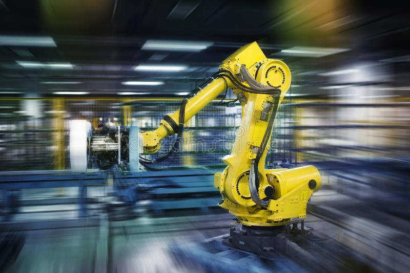 Robots in work. Robots work in a workshop royalty free stock images