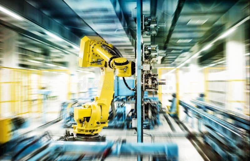 Robots in work. Robots work in a workshop stock photo