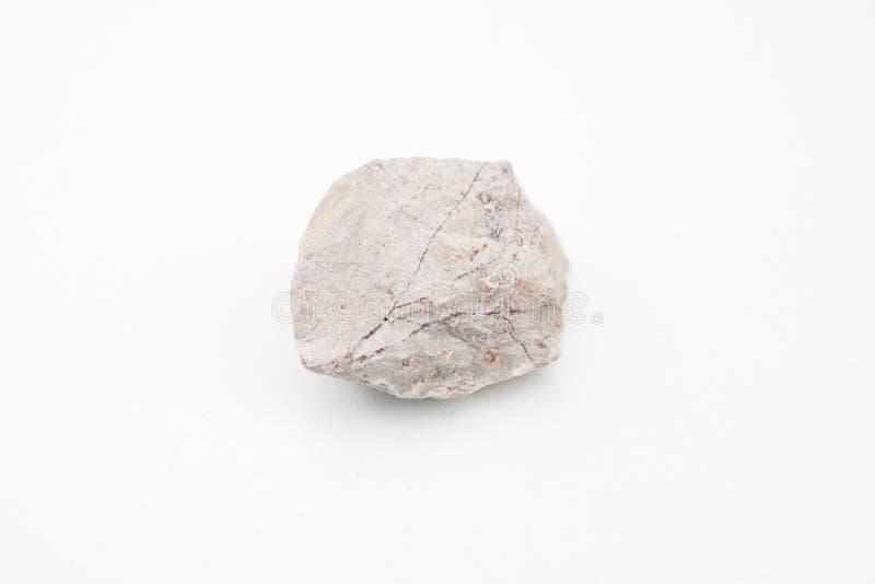 Roca de la marga sobre blanco fotografía de archivo