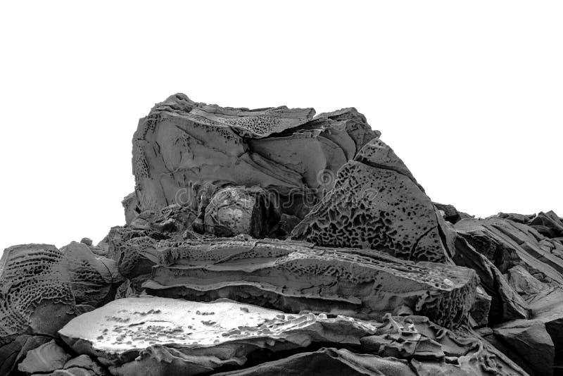 Roca demon?aca con im?genes aterrorizadas congelada en piedra fotografía de archivo