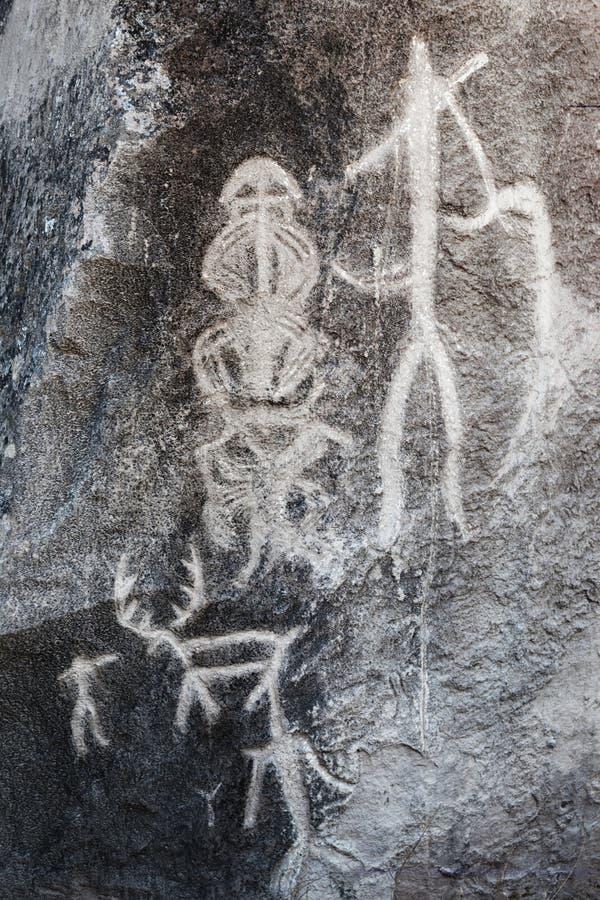 Roca-pintura prehistórica de los petroglifos de QOBUSTAN en Azerbaijan fotografía de archivo libre de regalías